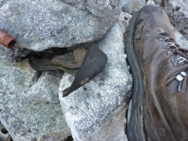 A comparison of some thin-soled boots of the late 19th century with the massively robust hiking boots of today.