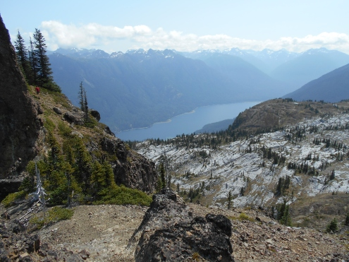 Elliott finding a way up Marble Peak with Buttle Lake down below.